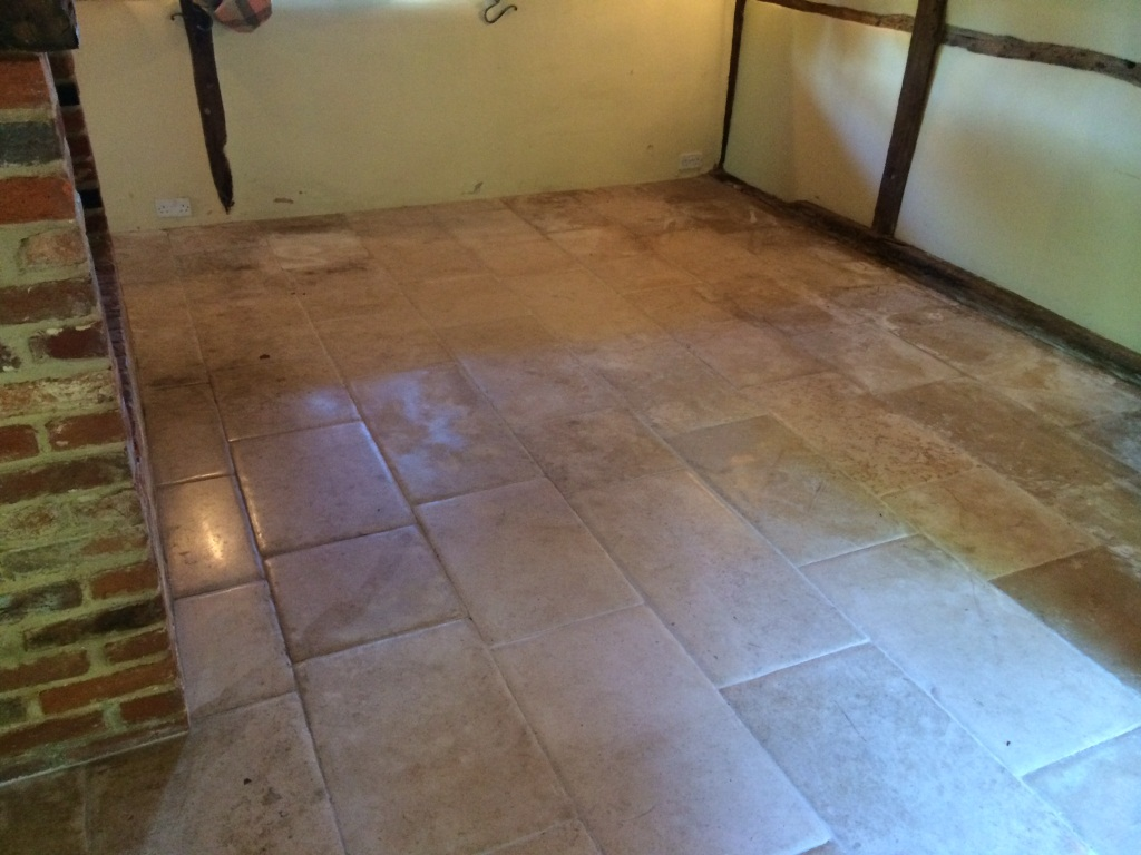 Waterleak Stains on Limestone Tiles Slough Before Cleaning