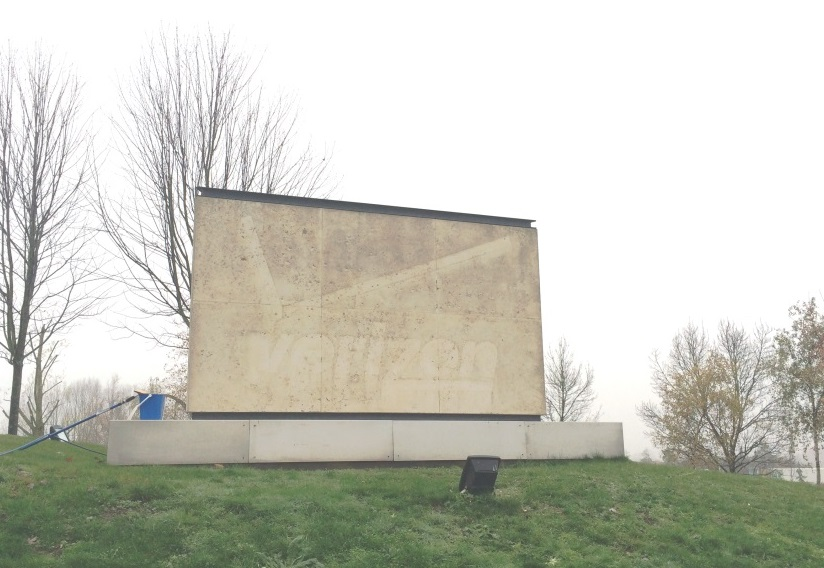 Limestone sign before cleaning reading