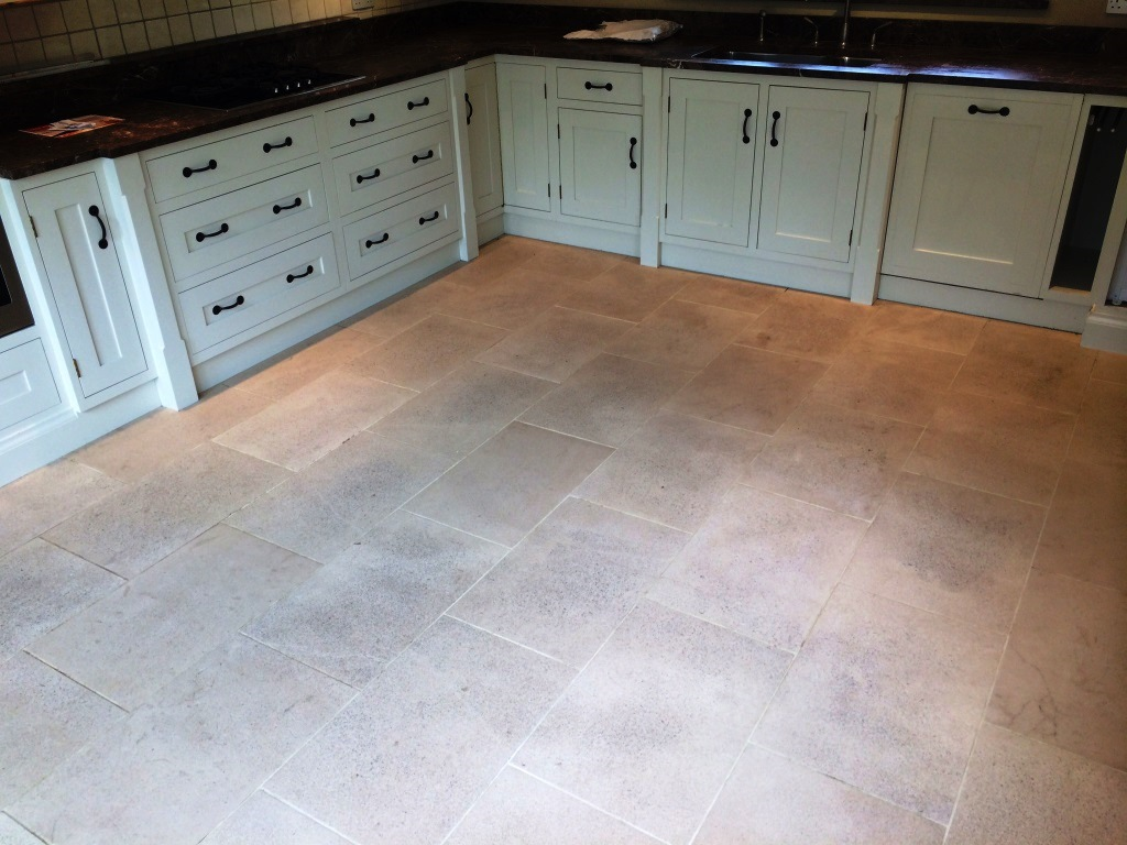 Limestone Kitchen Floor in Crookham before cleaning
