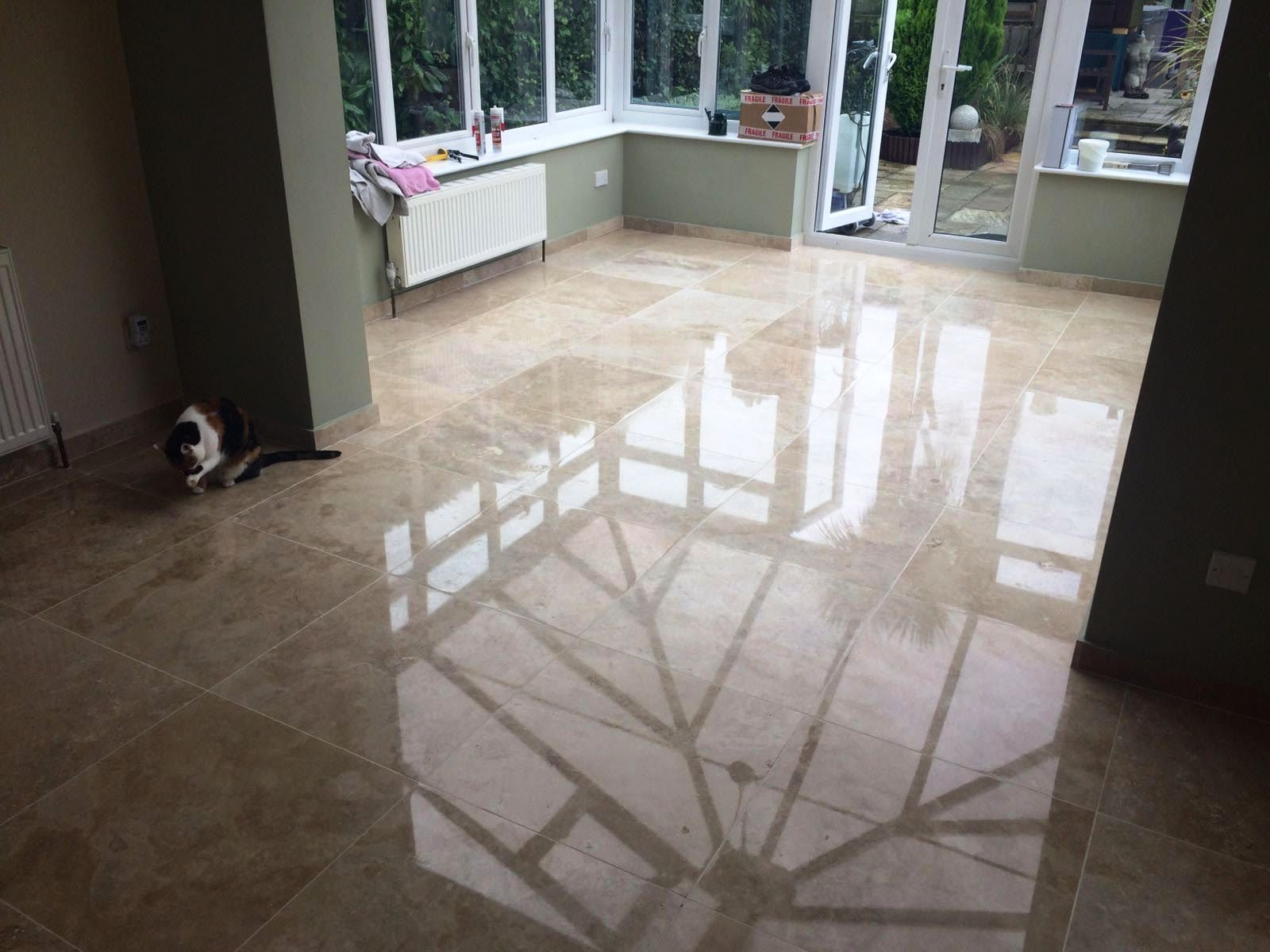 Scratched travertine tiled floor after restoration in Hunt