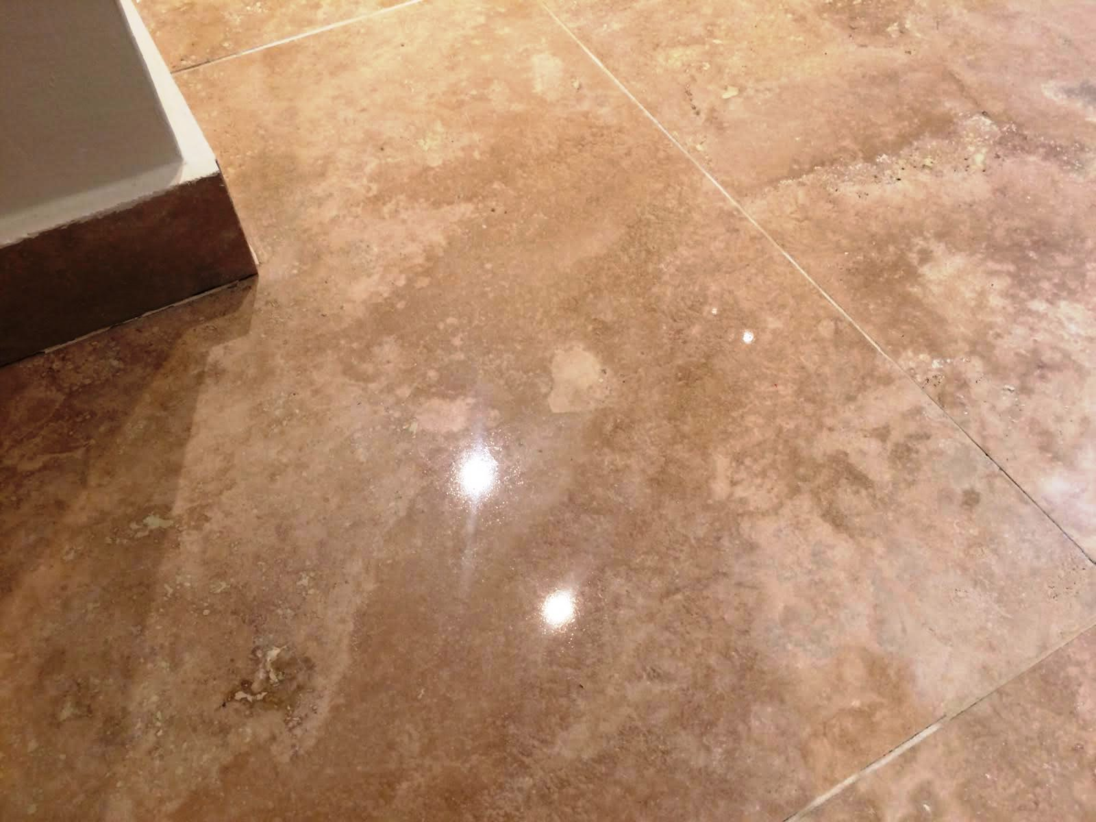 Scratched travertine tiled floor repaired in Hunt