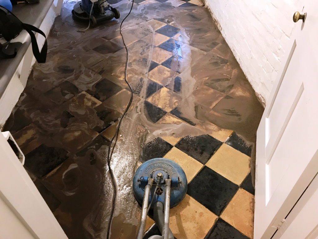 Yellow and Black Quarry Tiles During Cleaning Reading