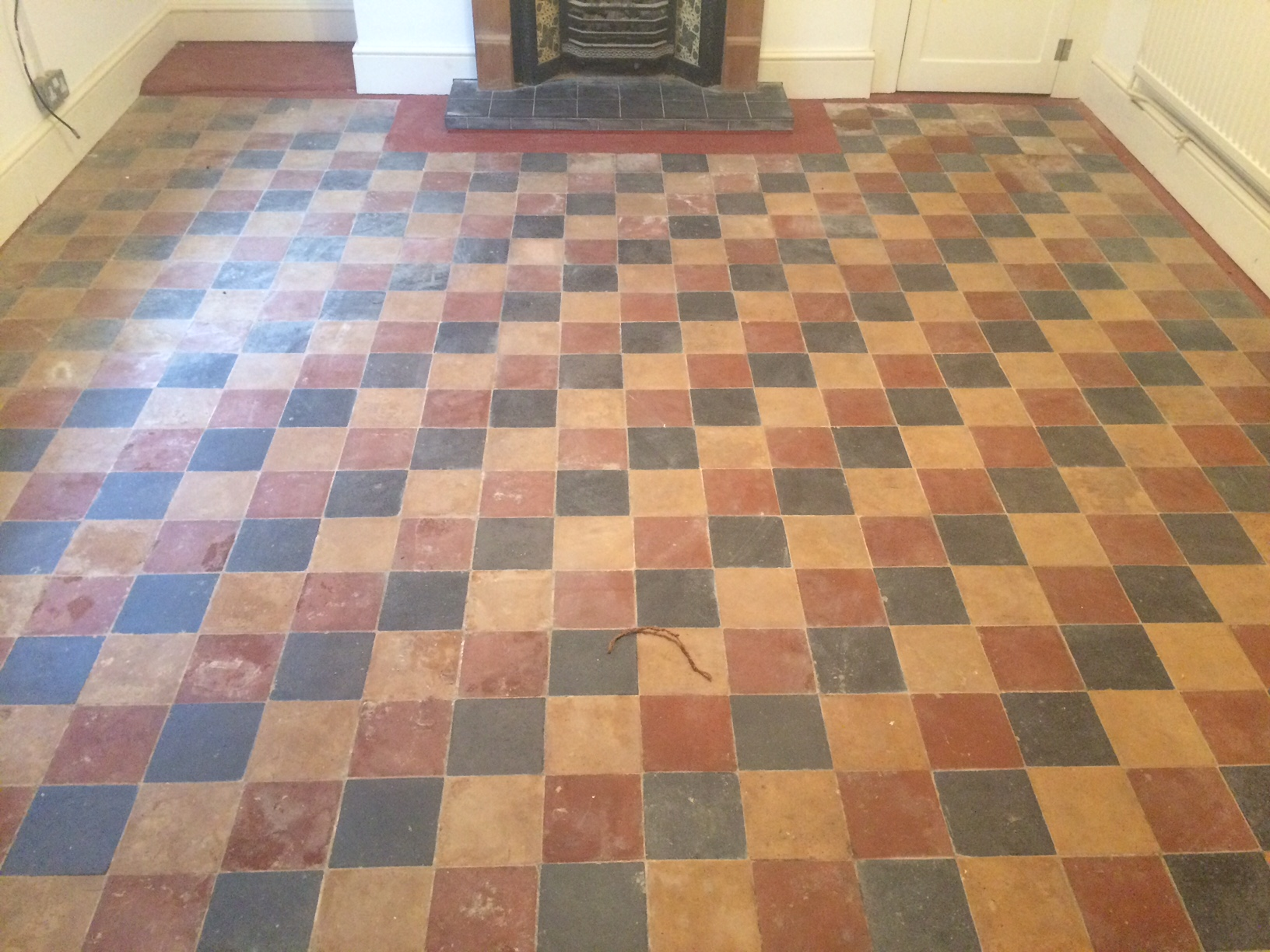 Restoring victorian floor tiles hidden under lino in berkshire victorian floor covered in lino pangboune before cleaning doublecrazyfo Gallery